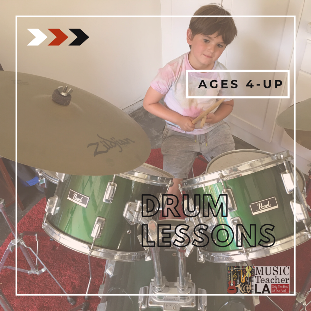 Child plays drum set during drum lesson