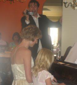 Piano teacher student duet at piano recital